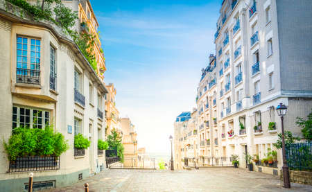 view of romantic Monmartre street with sttep steps, Paris, France with sunshine
