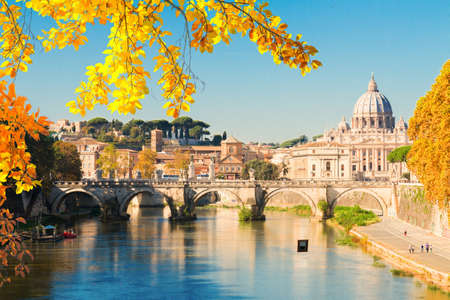 St. Peters cathedral dome over bridge and river water at bright fall day in Rome, Italy
