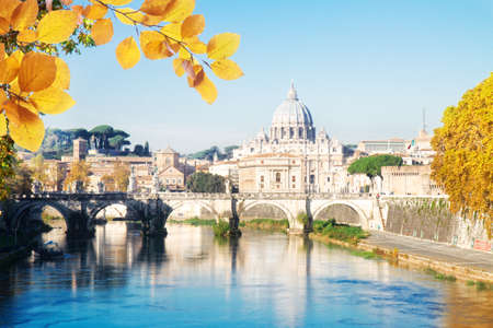 St. Peters cathedral over bridge and Tiber river in Rome at fall day, Italy