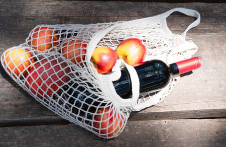 net shopping bag with red wine bottle