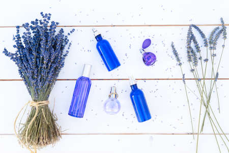 Lavender flowers and lavender oil and products in blue bottles