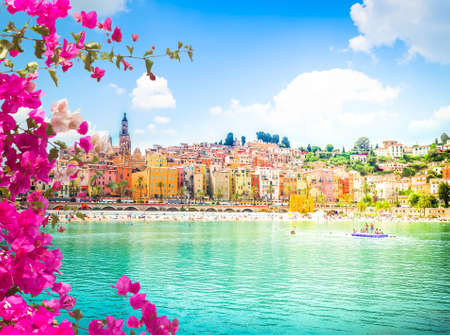 colorful houses of Menton old town waterfront, France, with flowers