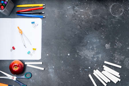 Back to school concept, border with colorful school supplies on blackboard, flat lay background with copy space
