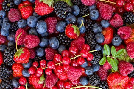 pile of freshh berries, top view food background