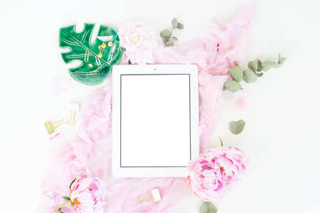 Creative wedding planner composition mock up, pink blanket, flowers on white background, copy space on screen. Flat lay, top view stylish art concept.