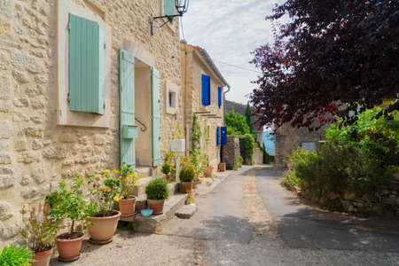 view of beautiful old town street with stairs of Provence at summer day, France