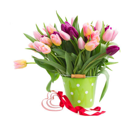 bouquet of multicolored tulip flowers in white pot close up isolated on white background Imagens