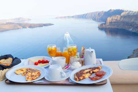 breakfast for two with coffee, fresh orabge juice and yogurt at morning by seaside