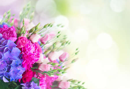Bright pink peony, eustoma and blue hortensia flowers on garden background Foto de archivo