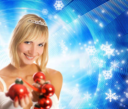 Beutiful girl in Christmas hat on abstract winter background Stock Photo - 2039194