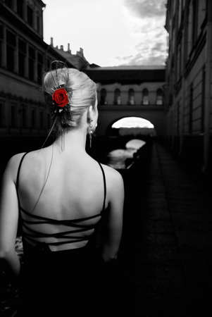 red evening: Black and white picture of a girl in old city