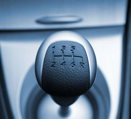 Six speed gear stick toned in blue (shallow DoF) photo