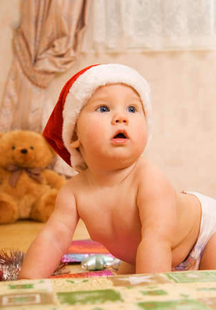 religious clothing: Adorable toddler in Christmas hat