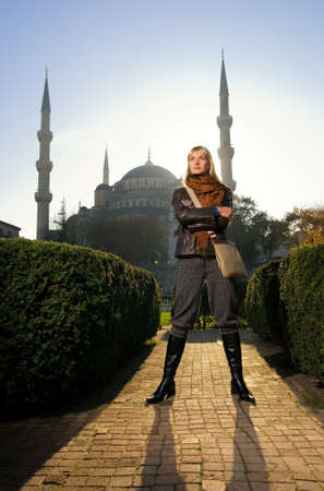 Beautiful blond girl in front of famous Blue Mosque (Turkey, Istanbul)