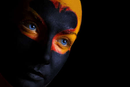 Portrait of a mysterious woman with artistic make-up on her face. Isolated on black background Stock Photo - 2179837