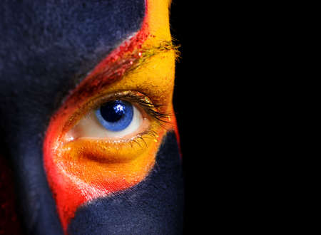Portrait of a mysterious woman with artistic make-up on her face. Isolated on black background Stock Photo - 2179838