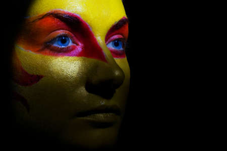 Portrait of a mysterious woman with artistic make-up on her face. Isolated on black background Stock Photo - 2181386