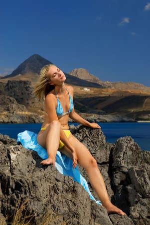 Beautiful girl relaxing near the sea Stock Photo - 2187011