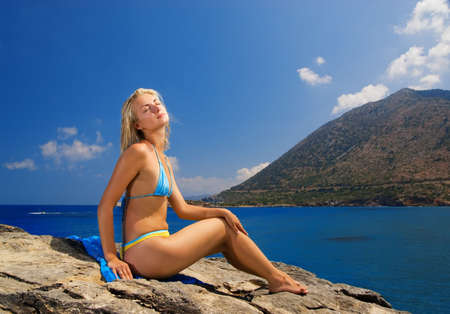 Beautiful girl relaxing near the sea Stock Photo - 2186989