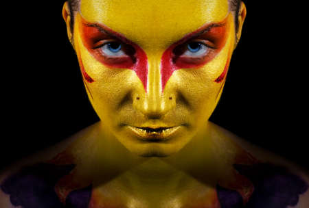 Portrait of a mysteus woman with artistic make-up on her face. Isolated on black background Stock Photo - 2187054