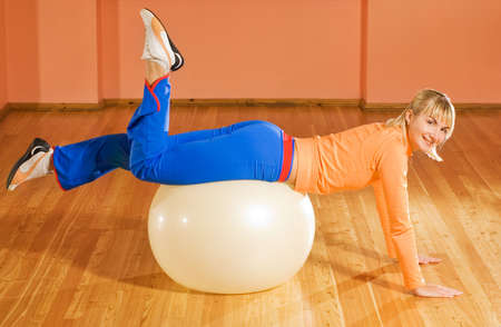 muscled: Fitness trainer on a fitball