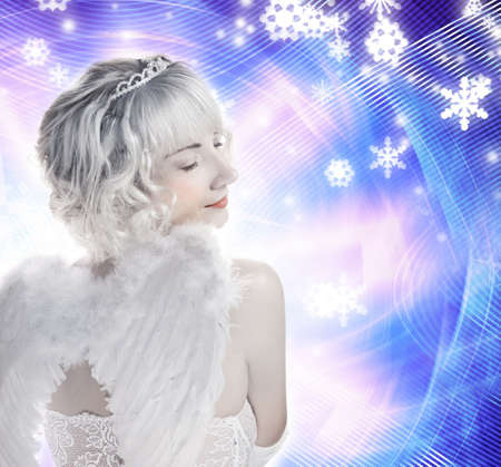 Beautiful Angel girl on abstract winter background photo