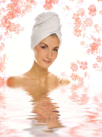 Beautiful girl with white towel on her head reflected in rendered water photo