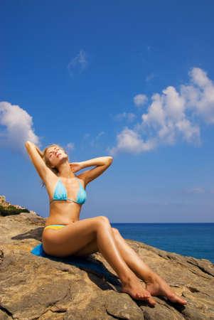 Beautiful girl relaxing near the sea Stock Photo - 2187046