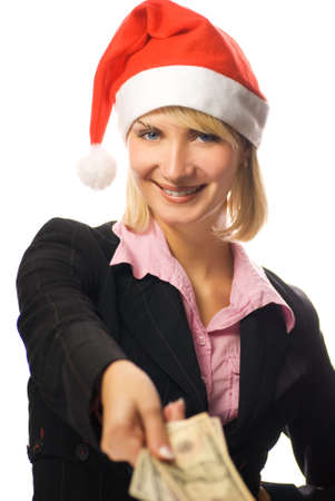 Business woman in Christmas hat holding american dollars in her hand photo