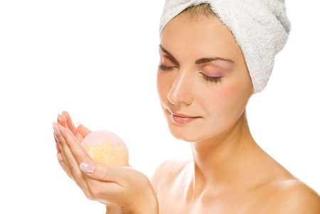 Lovely young woman with aroma bath ball in her hands. Isolated on white background Stock Photo - 2187002