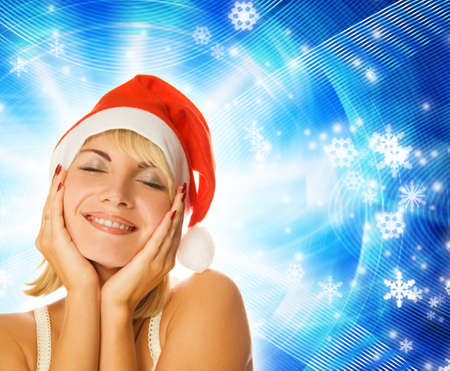 Beautiful girl in Christmas hat on abstract winter background photo