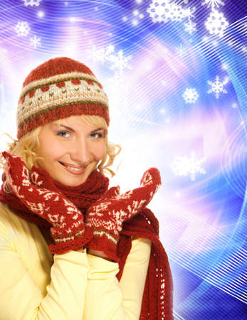 Beautiful girl in winter clothing on abstract background photo