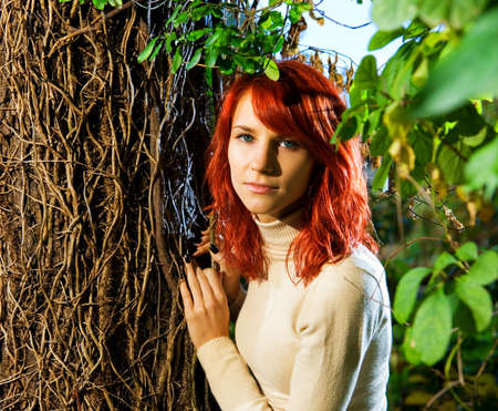 greenpeace: Beautiful redhead girl in the forest Stock Photo