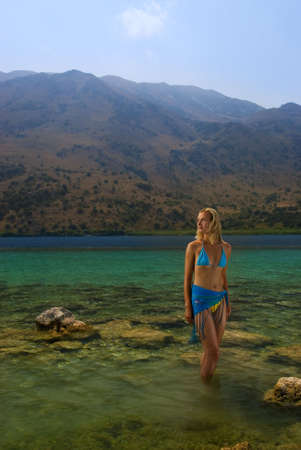 Beautiful blond girl standing in crystal clear water Stock Photo - 2202328