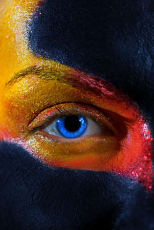 Portrait of a mysterious woman with artistic make-up on her face. Isolated on black background Stock Photo - 2202334