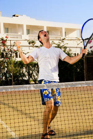 Tennis player screaming after winning a game Stock Photo - 2222039