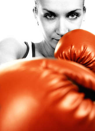 revenge: Sepia portrait of a girl in red boxing gloves Stock Photo
