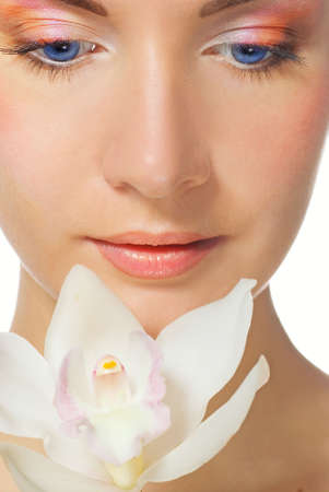 Close-up portrait of a beutiful girl with white orchid photo