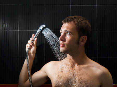 Handsome man in a shower photo