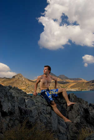 Handsome man relaxing in mountains, beautiful landscape view behind him Stock Photo - 2222104