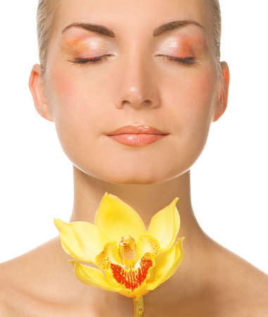 Portait of a lovely lady with yellow orchid Stock Photo - 2241230