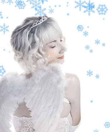 Blond angel girl with snowflakes around her Stock Photo - 2241374