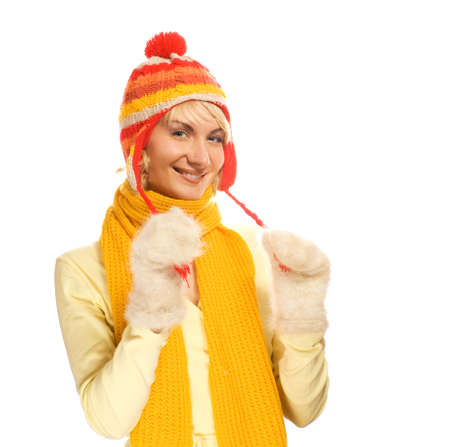 Beautiful girl in winter clothing isolated on white background photo