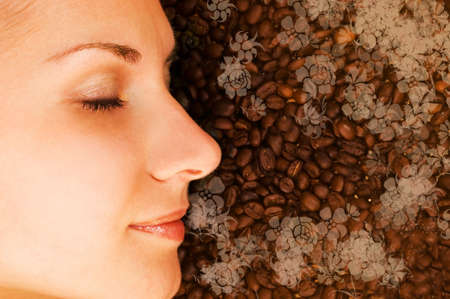 Beautiful girl breathing in scent of coffee photo