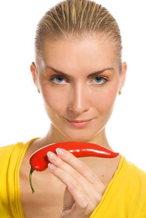 Beautiful girl with chili pepper photo