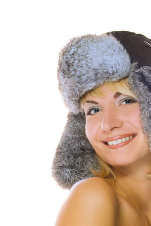 Sexy blond girl in winter fur-cap isolated on white background photo