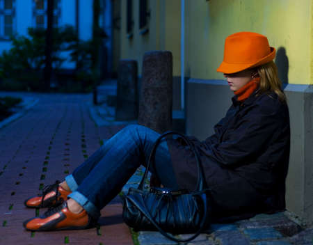 Beautiful girl in european old city at night time photo