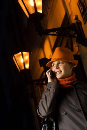Beautiful girl talks on the phone in european city photo