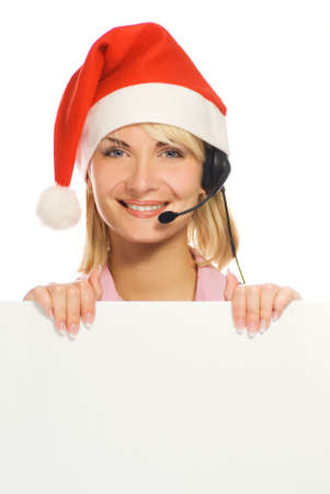 Mrs. Santa with a headset and white noticeboard isolated on white background photo