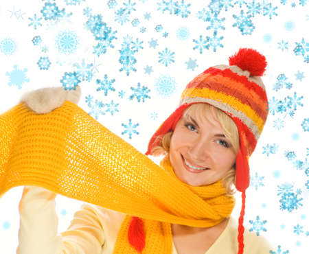 Beautiful smiling girl in winter clothing. Lots of possibilities to put your text on this image photo
